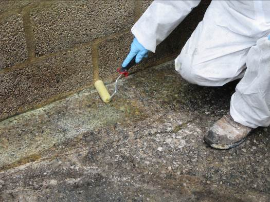 MaxPrime 100 being applied to concrete bund