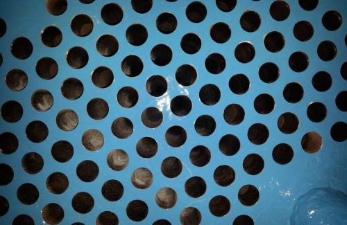 Heat exchanger tube sheet after being coated with MaxCeram 300 epoxy ceramic coating